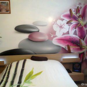 Le décor ambiance zen en tête de lit