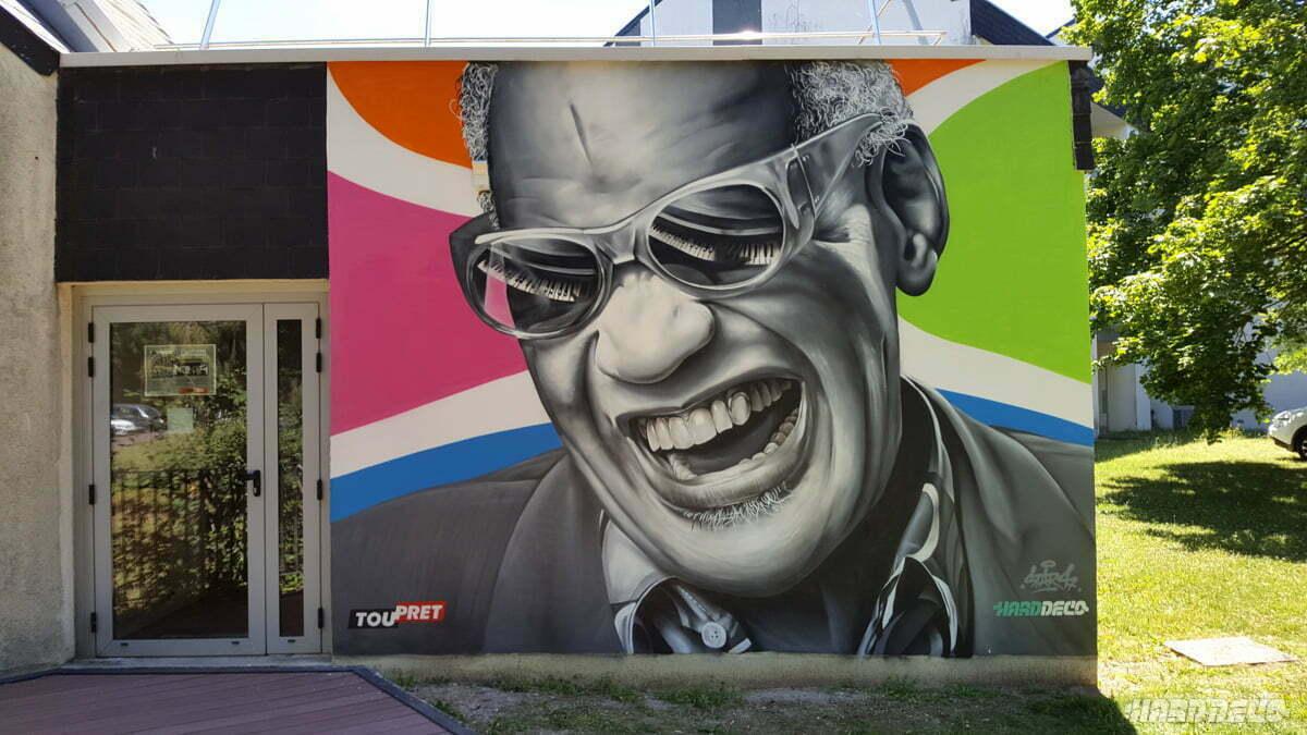 Fresque pour ugecam avec le portrait de Ray Charles